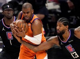 Chris Paul from the Phoenix Suns fights for a loose ball against Paul George of the LA Clippers in the Western Conference Finals. (Image: Porter Lambert/Getty)
