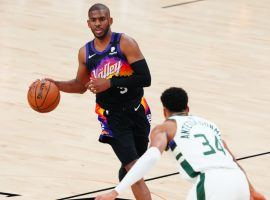 Giannis 'Greek Freak' Antetokounmpo from the Milwaukee Bucks defends Chris Paul of the Phoenix Suns in Game 1 of the 2021 NBA Finals at Phoenix Suns Arena. (Image: Getty)