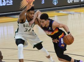 Devin Booker from the Phoenix Suns accelerates by Giannis 'Greek Freak' Antetokounmpo from the Milwaukee Bucks in a Game 2 victory in the 2021 NBA Finals at Phoenix Suns Arena. (Image: Peter Carini/Getty)