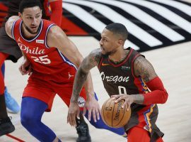Damian Lillard of the Portland Trail Blazers blows by Ben Simmons from the Philadelphia 76ers, but could the two swap teams after Dame requested as a trade? (Image: Soobum Im/USA Today Sports)