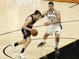 Brook Lopez (11) from the Milwaukee Bucks defends Dario Saric of the Phoenix Suns moments before Saric suffers a serious knee injury that derailed the rest of the postseason. (Image: Getty)