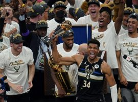Giannis 'Greek Freak' Antetokounmpo celebrates winning his first championship with the Milwaukee Bucks and their first title since 1971. (Image: Paul Sancya/AP)