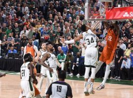 Giannis 'Greek Freak' Antetokounmpo of the Milwaukee Bucks prevents a potential dunk from Deandre Ayton of the Phoenix Suns in Game 4 of the 2021 NBA Finals. (Image: Getty)