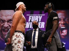 A COVID-19 outbreak could delay the third fight between Tyson Fury (left) and Deontay Wilder (right). (Image: Mikey Williams/Top Rank/Getty)