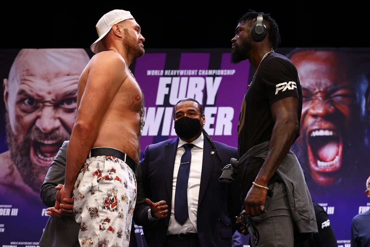 Tyson Fury Deontay Wilder COVID-19
