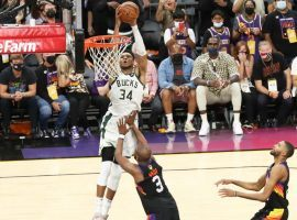 Giannis 'Greek Freak' Antetokounmpo of the Milwaukee Bucks completes an alley-oop dunk over Chris Paul from the Phoenix Suns to seal Game 5 of the NBA Finals. (Image: Porter Lambert/Getty)