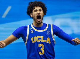 Johnny Juzang celebrates an overtime victory for UCLA during the 2020 March Madness college basketball tournament. (Image: Mark J. Rebilas/USA Today Sports)
