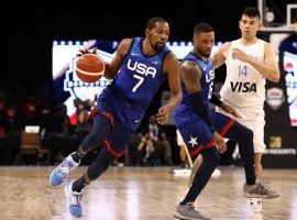Kevin Durant dribbles by teammate Damian Lillard for Team USA during an exhibition game against Argentina in an exhibition game at the Mandalay Bay in Las Vegas. (Image: Getty)