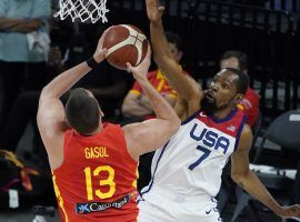 Kevin Durant from Team USA defends Marc Gasol from Spain in the final exhibition game in Las Vegas before both teams headed to Japan for the Tokyo Olympics. (Image: John Locher/AP)