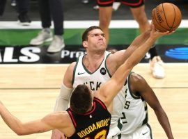 Brook Lopez of the Milwaukee Bucks grabs a rebound over Bogdan Bogdanovic of the Atlanta Hawks during a victory in Game 5 of the Eastern Conference Finals. (Image: Getty)