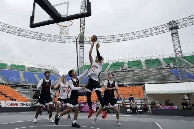 The first ever men's 3x3 basketball tournament will take place at the Tokyo Olympics, with Serbia entering as the favorite to win gold. (Image: Eugene Hoshiko/AP)