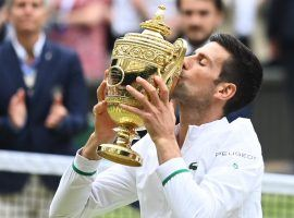 Novak Djokovic tied Roger Federer and Rafael Nadal with his 20th Grand Slam win at Wimbledon, and could break the record at the US Open. (Image: Toby Melville/Reuters)
