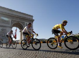 Le Tour champion Tadej Pogacar leads his teammates from UAE Team Emirates around the Arc de Triomphe in the final stage in Paris at the 2021 Tour de France. (Image: Stephane Mahe/Reuters)