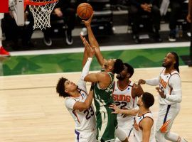 Four members of the Phoenix Suns try to defend Giannis 'Greek Freak' Antetokounmpo from the Milwaukee Bucks in Game 3 of the 2021 NBA Finals at Fiserv Forum in Milwaukee. (Image: Jeff Hansich/USA Today Sports)