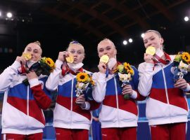 The Russian Olympic Committee (ROC) team upset the United States to win gold in the women's gymnastics team competition. (Image: Laurence Griffiths/Getty)