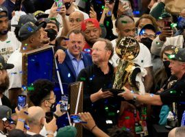 Head coach Mike Budenholzer clutches the championship trophy after the Milwaukee Bucks defeated the Phoenix Suns in the 2021 NBA Finals. (Image: Justin Casterline/Getty)