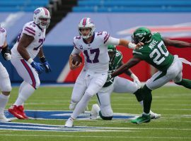 Josh Allen evades defenders from the New York Jets last season in Orchard Park, NY. (Image: Jets)