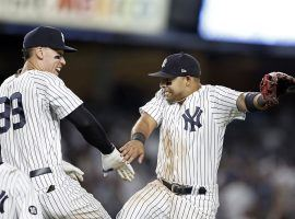 Aaron Judge and Andrew Velasquez from the New York Yankees celebrate a sweep of the Boston Red Sox at Yankee Stadium in the Bronx. (Image: Adam Hunger/Getty)