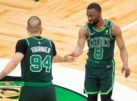 Kemba Walker (8) and Evan Fournier (94) slap hands during a game for the Boston Celtics last season. (Image: Getty)