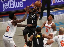 Kyrie Irving from the Brooklyn Nets drives the lane against Julius Randle of the New York Knicks at Madison Square Garden. (Image: Al Bello/Getty)