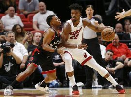 Miami Heat's Jimmy Butler is defended by Kyle Lowry from the Toronto Raptors during a game in early 2020. (Image: Michael Reaves/Getty)