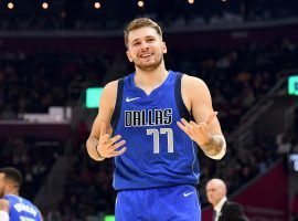 Luka Doncic smiles after knocking down a 3-pointer for the Dallas Mavericks. (Image: Jason Miller/Getty)