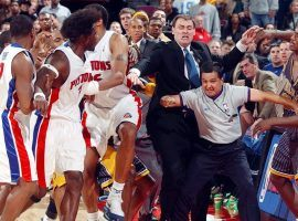Officials and coaches try to separate Ben Wallace of the Detroit Pistons and Ron Artest (far right) of Indiana Pacers moments before an on-court shoving match escalated into a brawl between players and fans at the Palace of Auburn Hills, Michigan in 2004. (Image: YouTube)