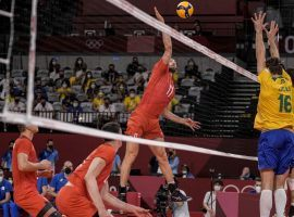 The ROC came from behind to beat Brazil and reach the men's volleyball gold medal match, where it will face France. (Image: Manu Fernandez/AP)