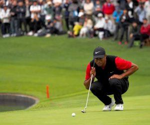 Tiger Woods lines up his shot with his favorite putter.