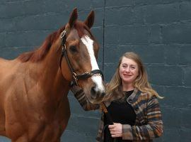 Assistant trainer Laura Moquett, the wife of trainer/co-owner Ron Moquett, was the only one who galloped Whitmore during his storied career. The 8-year-old Champion Sprinter retired Saturday. (Image: Richard Rasmussen/Sentinel-Record)