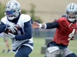 Dallas Cowboys QB Dak Prescott hands the ball off to RB Ezekiel Elliot during training camp on the first episode of the new season of HBO Hard Knocks. (Image: HBO)
