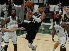 Giannis 'Greek Freak' Antetokounmpo grabs a rebound for the Milwaukee Bucks against the Brooklyn Nets in Game 6 of the 2021 Eastern Conference Finals. (Image: Michael McLoone/USA Today Sports)