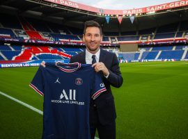 Messi took his first picture with the PSG shirt after signing his two-year deal at Parc des Princes. (Image: Twitter/PSGinside)