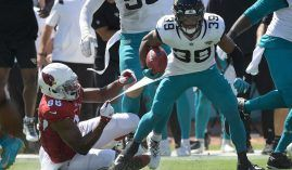 Kick returner Jamal Agnew from the Jacksonville Jaguars evades a tackle from the Arizona Cardinals during a record-setting touchdown. (Image: Phelan M. Ebenhack/AP)