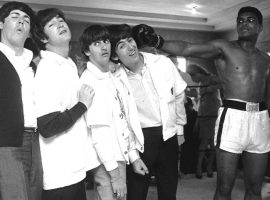 The Beatles visit Muhammad Ali at his training gym during a trip to Miami in 1964. (Image: AP)