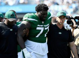 New York Jets offensive lineman Mekhi Becton exited the game in the third quarter against the Carolina Panthers due to a knee injury. (Image: Ricardo Hertz/Getty)