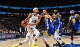 Ben Simmons from the Philadelphia 76ers drives the lane against Steph Curry of the Golden State Warriors, but team owner Joe Lacob dismissed any Simmons trade rumors. (Image: Getty)