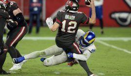 Samson Ebukam from the Los Angeles Rams sacks Tom Brady of the Tampa Bay Bucs in Week 3 at SoFi Stadium in LA. (Image: Jason Behnken/AP)