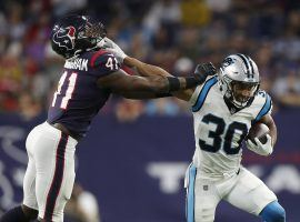 Rookie running back Chuba Hubbard from the Carolina Panthers stiff arms a defender from the Houston Texans in Week 3. (Image: Getty)