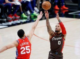 Damian Lillard from the Portland Trail Blazers shoots a deep 3-pointer over Ben Simmons of the Philadelphia 76ers, but the two All-Stars are the subject of trade rumors. (Image: Getty)