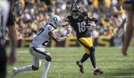 Pittsburgh Steelers wide receiver Diontae Johnson stiffarms a defender from the Las Vegas Raiders. (Image: Matt Durisko/Getty)