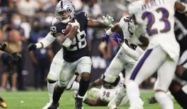 Raiders running back Josh Jacobs evades tacklers from the Baltimore Ravens during a Monday Night Football Game at Allegiant Stadium in Las Vegas. (Image: Getty)