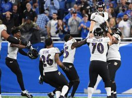 Baltimore Ravens kicker Justin Tucker is hoisted by his teammates after he defeated the Detroit Lions with a record-setting field goal at Ford Field in Detroit. (Image: Getty)