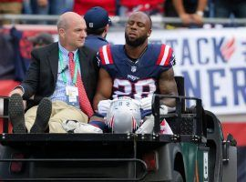 A dejected New England Patriots running back James White is carted off the field at Foxboro after a hip injury against the New Orleans Saints. (Image: Getty)
