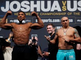 Anthony Joshua (left) will defend his heavyweight titles against the smaller but undefeated Oleksandr Usyk (right) on Saturday in London. (Image: Getty)