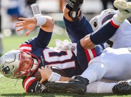 Mac Jones, rookie quarterback from the New England Patriots, is sacked by the New Orleans Saints last week at Foxboro. (Image: Marco Esquandoles/Getty)