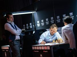 Ian Nepomniachtchi (left) watches Magnus Carlsen (center) play Aryan Tari (right) in the second round of Norway Chess. Nepomniachtchi and Carlsen will face off for the World Chess Championship later this year. (Image: Lennart Ootes/Norway Chess)