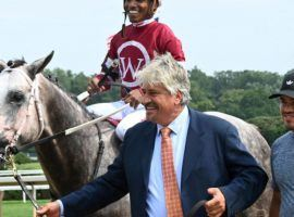 A beaming Steve Asmussen escorts Stellar Tap and Ricardo Santana Jr. to the Saratoga winner's circle after the juvenile made the conditioner the winningest trainer in North American history. Stellar Tap is the 3/1 morning-line favorite to win the Grade 3 Iroquois Stakes at Churchill Downs. (Image: Chelsea Durand/Coglianese Photos)