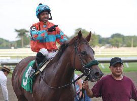 Jockey Tomas Mejia was suspended for 10 years after a photo revealed he had a prohibited electronic device in his hand during a Sept. 3 allowance at Monmouth Park. (Image: Equi-Photo)
