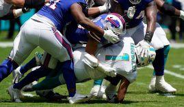 Buffalo Bills defenders smush Miami Dolphins quarterback Tua Tagovailoa in the first quarter of Week 2 at Hard Rock Stadium. (Image: Getty)